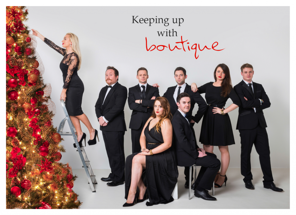 the staff of We Are Boutique wearing black tie outfits. parody of kardashians' christmas card