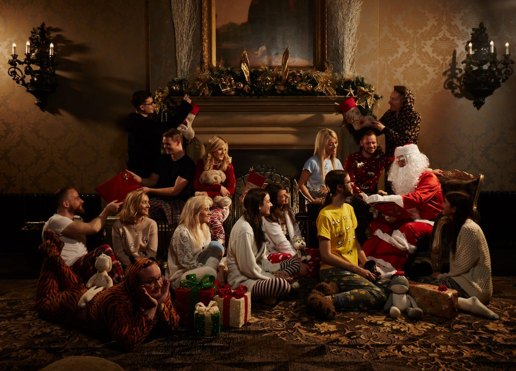 The Staff of We Are Boutique in Pyjamas Gathered Around Santa as he Reads a Story