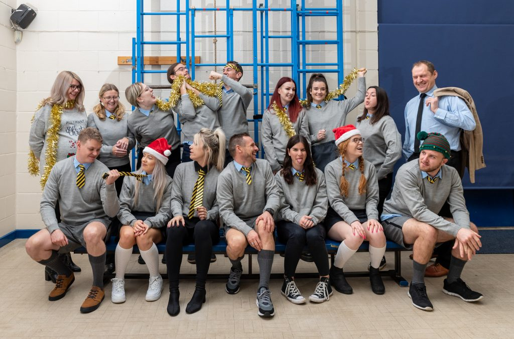 The Staff of We Are Boutique Dressed up as School Children for their 2018 Christmas Card